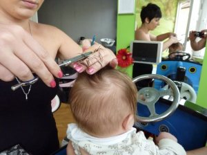 Child's first hair cut at Happy Faces Hair Salon